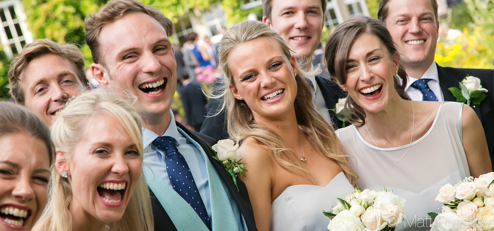 Wedding-Bridal-Party-laughing-in-the-grounds-of-Cheshire-wedding-venue-Hilltop1
